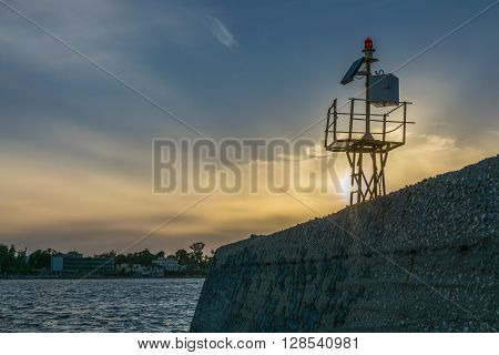 Small lighthouse, metal structure during the sunset in Kos Island.