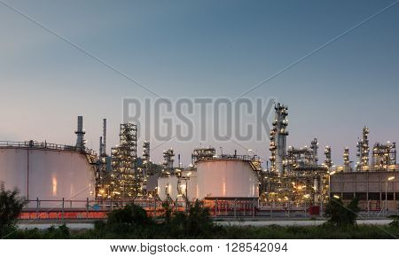 Oil Refinery Factory At Sunset