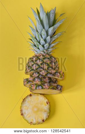 Pineapple slices isolated on yellow background