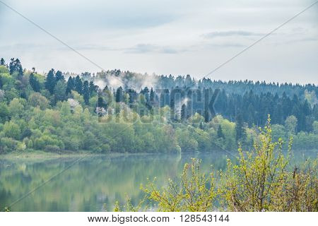 Hazes above green hills on Solina lake shore (Bieszczady mountains, Poland), in the beginning of May