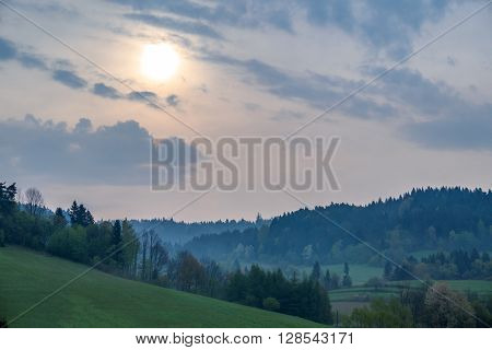 Hazy morning  above Solina lake shore (Bieszczady mountains, Poland), in the beginning of May