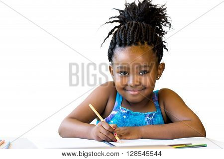Close up portrait of little african girl holding color pencil at desk.Isolated on white background.