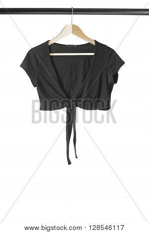 Black jacket on wooden clothes rack on white background