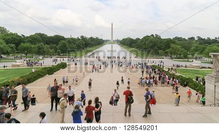 Washington DC USA - May 16 2014: People in front of Lincoln Memorial building with far background is Washington Monument with green tree and long reflecting pool.