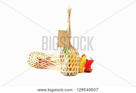 colorful thai sweets in Wicker round bamboo basket on white background with blank paper for note