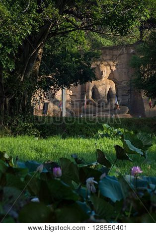 POLONNARUVA, SRI LANKA - May 01 2016: Buddha statue face on yellow stone wall at Gal Vihariya on May 01 2016 in Polonnaruwa, Sri Lanka