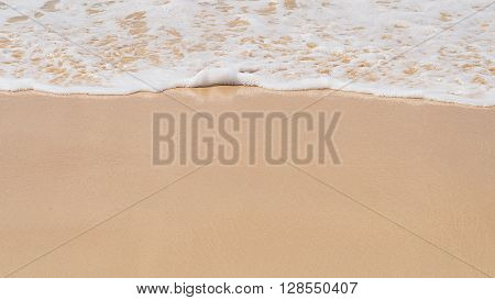 Sand background with wave. Beautiful sand background and wave from sea. Sand Texture background. Closeup of sand.
