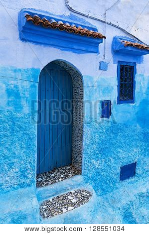 Detail of a door and window in the town of Chefchaouen in Morocco