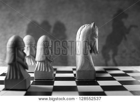 Shadow of chess knight appearing as a rearing horse