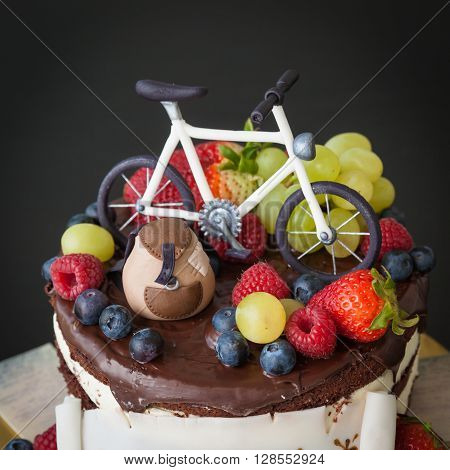 Chocolate cake with fresh fruit on the theme of travel