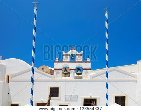 Crete Greece. 18.06.2015  Beautiful typical blue dome church over blue sky on Santorini island Greece