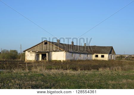 An empty horse stable in the Russian countryside in the early morning