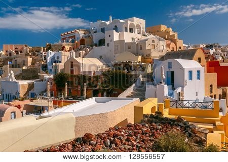 Picturesque view of white houses in Oia or Ia on the island Santorini, Greece