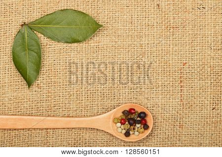 Bay Leaves And Peppercorn Spoon On Burlap Canvas