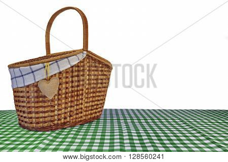 Picnic Basket On The Green Checkered Tablecloth Isolated On White