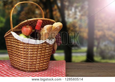 Picnic Basket With Food And Drink On The Wood Table