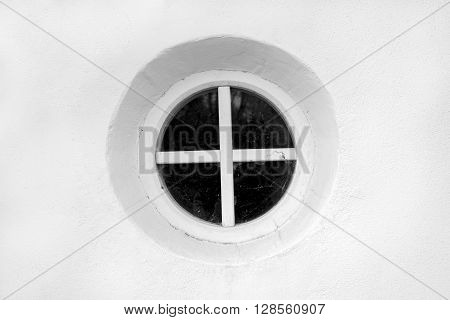 old round window on the white wall of the bell tower of the Orthodox Kiev