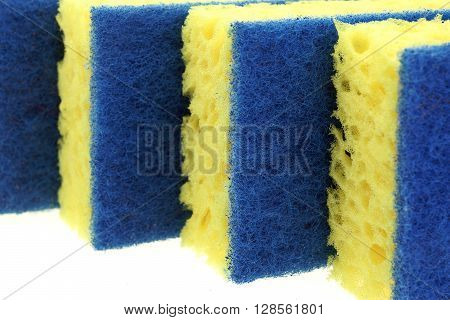 Four New Absorbent Sponge With Hardwearing Scourer Isolated On White