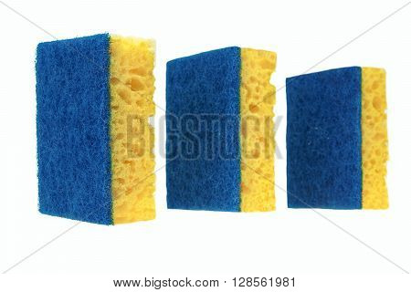 Three New Absorbent Yellow Sponge With Blue Hardwearing Fiber Scourer Isolated On White Background Close Up