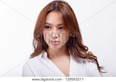 Attractive Asian American businesswoman looking away from camera