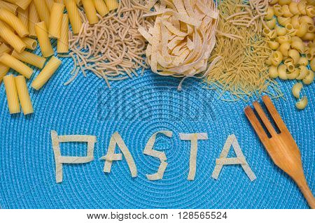 pasta food lettering, food letters, mixed pasta, dried pasta, pasta selection, pasta top view, Raw pasta, various pasta, blue background
