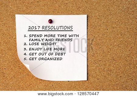 2017 new year's resolutions pin on a cork board