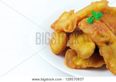 Banana fritters on a plate with copy space