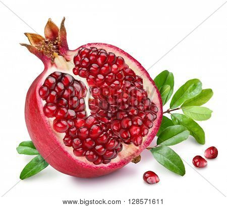 Pomegranate fruit with green leaves on the white background.