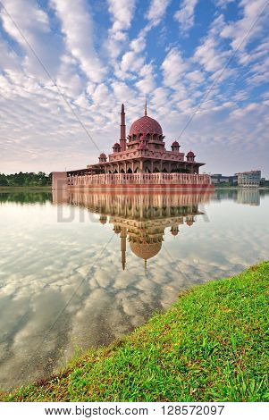 Morning view of Putra Mosque and mirror like reflection, The Putra mosque also known as Masjid Putra in Malay language, its the principal mosque of Putrajaya, Malaysia.