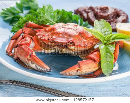 Seafood dish - cooked crab with lemon and herbs.