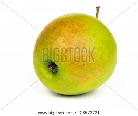 Ripe green apple with red spots isolated on white background.