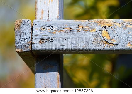 Old, weathered wooden beams with blue color in the sunshine.