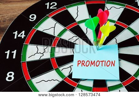Darts And Bull Eyes With Word Promotion On Paper