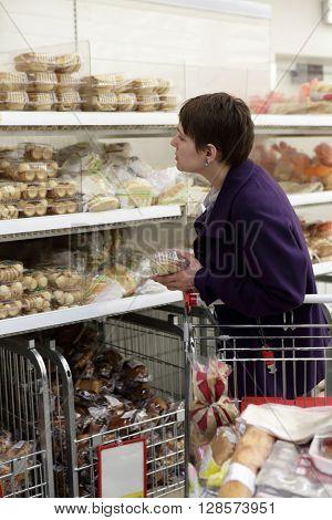 Woman In Bakery Shop