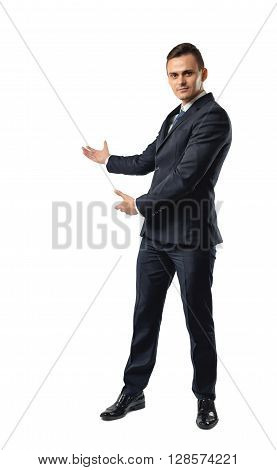 Businessman stands showing the direction by both hands. Business staff. Office clothes. Dress code. Affability. Invite and guide.
