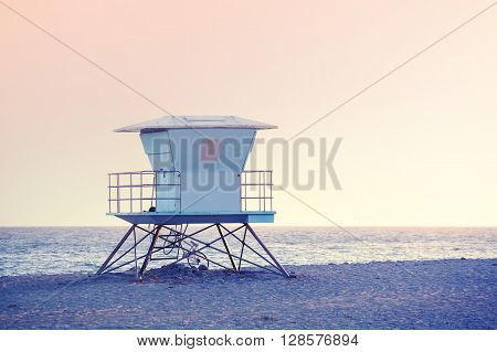 Rose Quartz And Serenity Color Toned Picture Of A Lifeguard Tower.