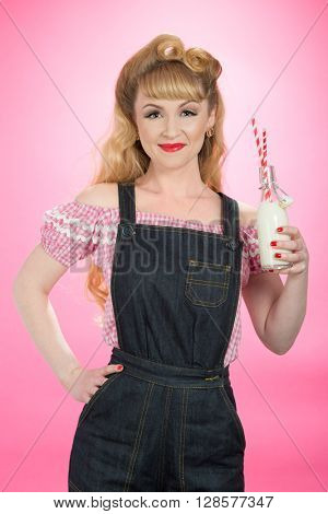Pin Up girl drinking milk from a retro swing top bottle with straws