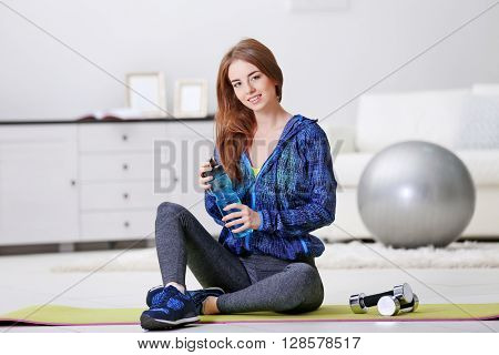 Sports young girl with fit ball at home