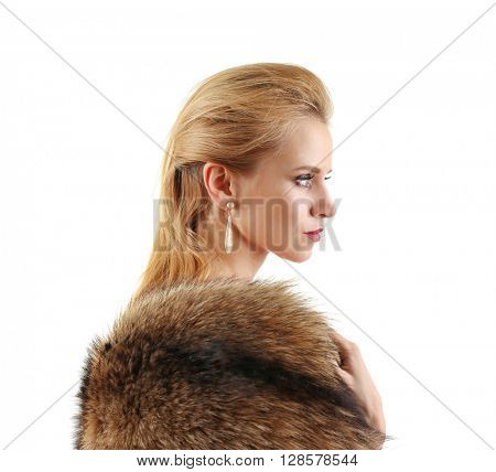 Young beautiful blonde girl wearing perfect makeup and posing half-faced in a fur over white studio background