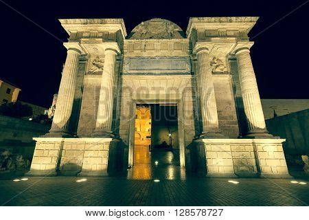 Bridge Gate (Puerta del Puente) triumphal Renaissance arch illuminated at night in Cordoba Andalusia Spain