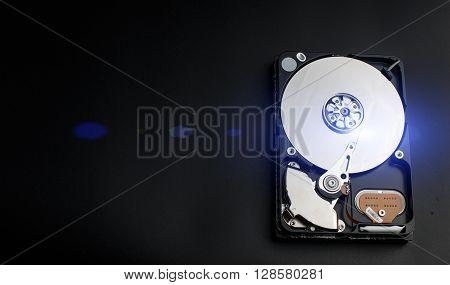 Open hard disk on a black background