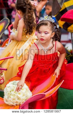 Banos De Agua Santa - 29 November, 2014 : Latin Girl Dressed Like A Princess Walking In A Carriage Through The Streets Of Banos De Agua Santa, South America In Banos De Agua Santa On November 29, 2014