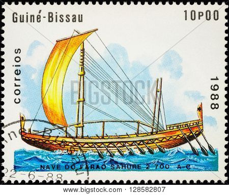 MOSCOW RUSSIA - MAY 01 2016: A stamp printed in Guinea-Bissau shows image of ancient Egyptian boat during Sahure Pharaoh series