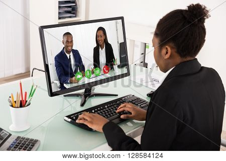 Young African Businesswoman Videoconferencing With Colleagues On Computer