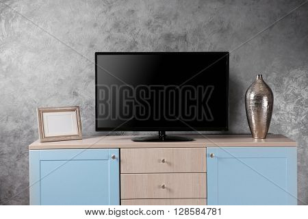 Big wooden cupboard and TV.