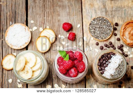 set overnight oats with berries coconut peanut butter Chia seeds and chocolate chips