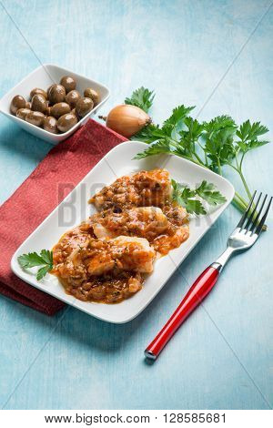 cod fillet with  olives and  tomatoe sauce