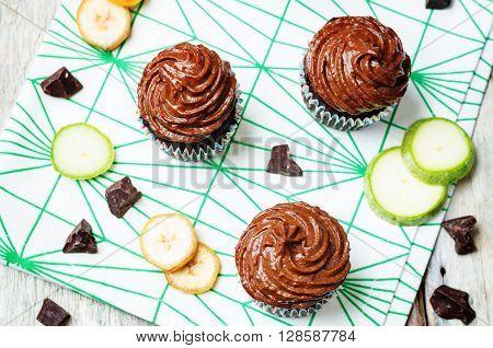 Chocolate zucchini banana cupcakes with chocolate avocado banana peanut butter cream frosting.