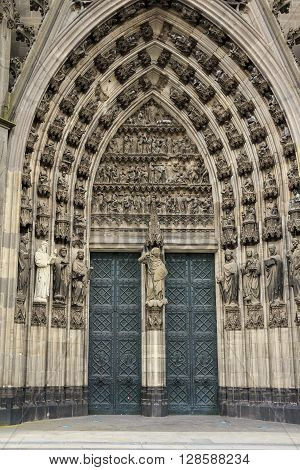Cologne, Germany - May 16: There's one of medieval entrances to gothic Cologne Cathedral May, 16 2013 in Cologne, Germany.