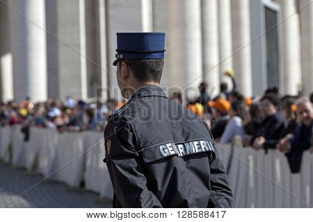 Rome Italy - April 30 2016: A policeman gendarmerie controls the crowd in Piazza San Pietro on the occasion of the Jubilee of the armed forces.